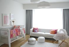 All White Nursery Guest Room with White Sofa, Crib, Rug and Long Grey Curtain | Decorative Bedroom