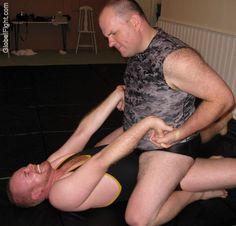 man twisting hands neck breakers hairy mens wrestling
