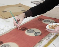 Barbara of BZ Design paints stems onto her printed design. She uses natural dyes and materials to create gorgeous, delicate scarves.