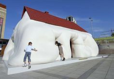 Some houses seem to eat you alive... http://www.funfluster.com/funny/334-unusual-houses.html
