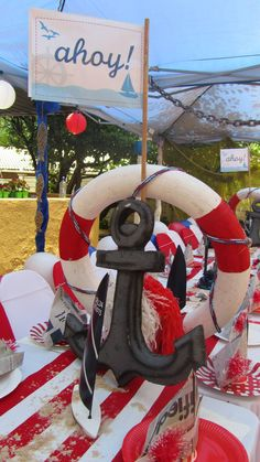 Kids Sailor Party - By www.supakids.co.za  Wrap styrofoam ring in red and white fabric, paint wooden anchor black