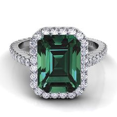 """Brides.com: Engagement Rings with Colored Stones. Style XE101-EM-EM, """"Carezza"""" single shank engagement ring with emerald center stone, $3,320, Danhov Center stone not included in price.  See more Danhov engagement rings."""