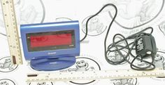 SHARP DIGITAL WALL PLUG ALARM & REGULAR LCD CLOCK BLUE COLOR USED SPC060  #Sharp