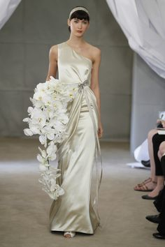 Carolina Herrera spring 2013 with cascading white orchid bouquet. #celebritystyleweddings.com #celebstylewed