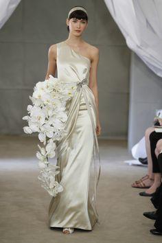 Carolina Herrera spring 2013 with cascading white orchid bouquet. #celebritystyleweddings.com #celebstylewed