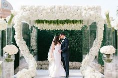 Brimming and bountiful our acrylic structure was adorned with the lush white flowers that cascaded down to the aisle. @GellerEvents and the couples exquisite style and taste set the tone for this modern ceremony design.   As seen in @InsideWeddings    Creative Team: Event Planner: @gellerevents   Design & Decor: @revelryleighc for @revelryeventdesign   Event Design & Florals:@jeffleatham   Photography: @heatherkincaidphoto   Venue: @montagebh   Lighting: @lightenup_inc   Linens…