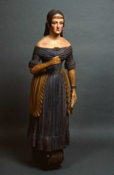"""Figurehead of ship """"Creole,"""" 1847, American. Since the early years of recorded history, figureheads have decorated the bows of vessels, to invoke beneficent guiding spirits, to ward off evil spirits, and to help insure safe passage."""