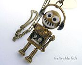Steampunk music robot necklace,with flexible hands,feet and headset.antique brass NR02