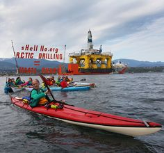 Its easier to unfurl a banner across a row of kayaks than you might think.