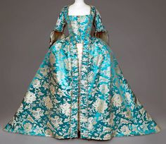 Manteau de robe à la française, mid 18th Century, France, blue (turquoise?) damask silk and foliage of cream peonies and grenades probably manufactured in China | Daguerre Auctions