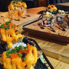 """Favorites  (L-R) Soft shell crab Kani aburi and Hamachi aburi  . For @ooma_ph they give you a brush if you want some soy sauce with their delicious #aburi rolls. Aburi-style rolls are half-torched and half raw """"topped"""" rolls to give that extra 'oomph!' in flavor.  #eat #eatmore #iphoneonly #iphoneography #nofilter #ooma #food #foodstagram #foodporn . (Please excuse the fact I don't know what it's 'officially' called)"""