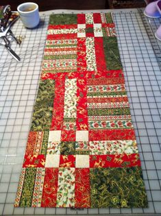 A Christmas table runner. I use it osver my table cloth. Since it is quilted you don't need additional hot pads or trivets. Christmas Patchwork, Christmas Sewing, Christmas Fabric, Christmas Quilting, Table Runner And Placemats, Table Runner Pattern, Quilted Table Runners, Place Mats Quilted, Quilted Table Toppers