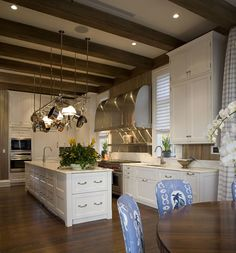 love this...white cabinets - wood floors and beams - stainless hood