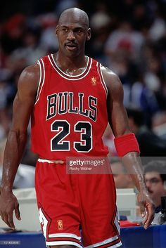 Michael Jordan of the Chicago Bulls looks on against the Golden State Warriors on January 1997 at San Jose Arena in San Jose, California. Basketball Legends, Sports Basketball, Basketball Players, Basketball Stuff, Basketball Socks, Charlotte Hornets, Toronto Raptors, Golden State Warriors, Chicago Bulls