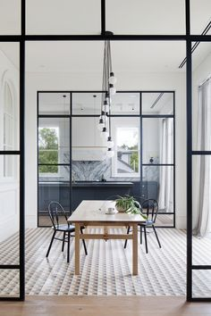 I love the glass 'wall' entry into the kitchen creating the broken-plan rooms | Winner - Australian Interior Design Awards