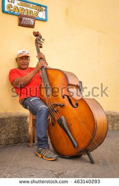 SANTIAGO DE CUBA, CUBA - CIRCA AUGUST 2015: Portrait of a double bass player in Santiago de Cuba, Cuba