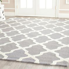 Anchor your living room or parlor with this hand-tufted wool rug, showcasing a trellis motif in gray and ivory. Find this and more at jossandmain.com