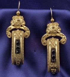 Etruscan Revival Gilt Earrings, the oval hoops with bead and ropetwist accents, three fancy-cut black glass highlights, lg. 1 7/8 in.,