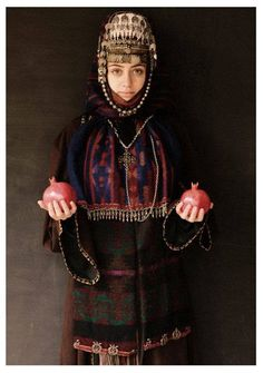 Armenian women in traditional clothes with pomegranates.