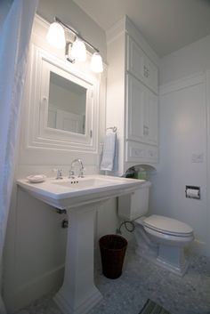 Over the toilet build in storage. Great idea for a small space.