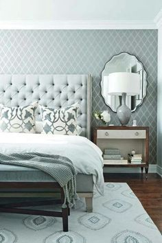 love the stenciled wall (or maybe it's wallpaper)....never thought about a mirror above the nightstand.