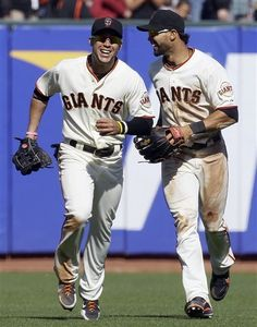 San Francisco Giants Right Fielder Gregor Blanco, Left, And Center Fielder Angel Pagan Celebrate