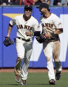 San Francisco Giants Right Fielder Gregor Blanco, Left, And Center Fielder Angel Pagan Celebrate
