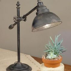 This rustic lamp is perfect for your home office and measures 8″ diameter base and about 30″ tall when extended fully upright. Lamp arm is adjustable and measures 21″ long....