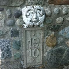 Very awesome  Alice On Wonderland-esque stone carving/house number