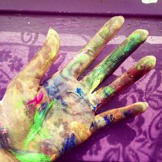 Not sure if real hand covered in paint or a painting...