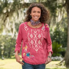 """ARCHIPELAGO EMBROIDERED TEE--Our delightfully bright long-sleeved tee boasts a soft, slouchy silhouette with raw-edges, exposed seams and rolled neckline. Polyester/cotton. Machine wash. Imported. Catalog exclusive. Sizes XS (2 to 4), S (6 to 8), M (10 to 12), L (14), XL (16). Approx. 29""""L."""