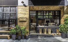 A new coffee shop has recently opened in Hong Kong that was designed so the people drinking coffee can interact with people on the street. Designed by James JJ Acuna of JJA / Bespoke Architecture,. Interior Simple, Cafe Interior, Design Exterior, Interior Exterior, Restaurant Design, Restaurant Bar, Coffee Stands, Coffee Shop Design, Shop House Plans
