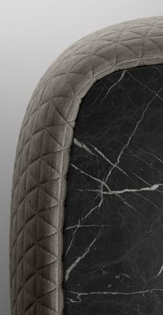 A detailed view of the Bigun black coffee table in marble and fabric.