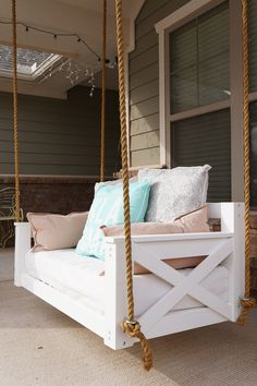 The perfect porch swing for cozy evenings on the front or back porch. This swing pictured here has a crib size mattress and is hanging from the ceiling with Manila rope. Porch Swing Cushions, Front Porch Swings, Porch Bed Swing Plans, Balcony Swing, Front Porches, Diy Crib, Diy Bed, Crib Swing, Swing Beds