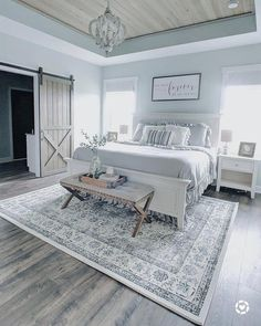 modern farmhouse master bedroom decor, farmhouse bedroom design rustic neutral bedroom design with white walls and white bedding nightstand decor, side table styling and wall art with barn door and chandelier and shiplap ceiling Farmhouse Master Bedroom, Farmhouse Interior, Farmhouse Furniture, Farmhouse Decor, Farmhouse Homes, Farmhouse Ideas, Farmhouse Style, White Bedroom, Country Furniture
