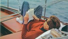 JFK reading aboard the Manitou off the coast of Maine. (from: http://john-f-kennedy-and-his-family.tumblr.com/)