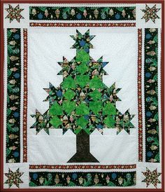 Christmas tree quilt with stars.  Class by Roz Heller, Annie's Quilting Den