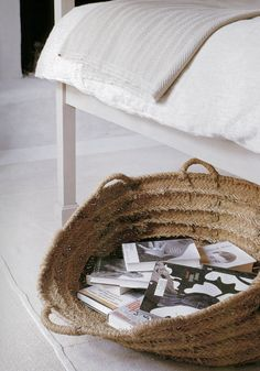 books in basket under bed