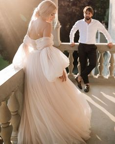 A dramatic ballerina ballgown made of pleated silk tulle in shades of ivory and blush, the Bellina accentuates at the chest with an embroidered embellishment and wrap around off-the-shoulder sleeve design. Cream Wedding Dresses, Elegant Wedding Dress, Bridal Dresses, Wedding Gowns, Tulle Wedding, Vintage Ball Gowns, Ethereal Wedding, Fairytale Dress, Princess Wedding