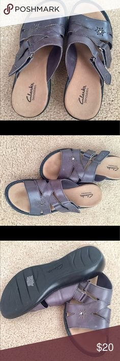 Clark Sandals Dark grey in color. These Clark sandals don't disappoint with style and comfort. Easy worn and in good condition. Clarks Shoes Sandals