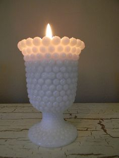 Milk Glass  . . .    Hobnail Milk Glass Votive Candle Holder Footed Fenton