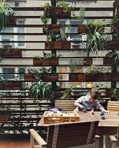 The homeowners son plays in front of a living wall created by urban landscaper Kari Elwell Katzander of Mingo Design. Photo by: Roland Bello   Dwell