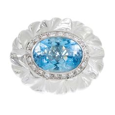 Carved Rock Crystal, Aquamarine and Diamond Dome Ring   From a unique collection of vintage cocktail rings at http://www.1stdibs.com/jewelry/rings/cocktail-rings/