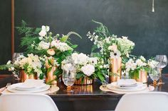 Copper vases and white flower arrangements. See more of this metallic trend here: http://www.mywedding.com/articles/copper-wedding-details/