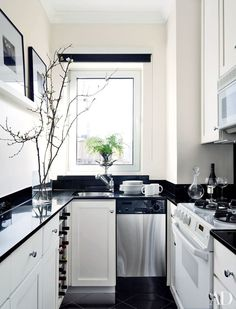 Designer Larry Laslo updated the galley kitchen of a New York apartment with a black-and-white palette | archdigest.com
