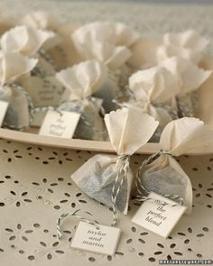 Wedding favours - tea...really easy to make...buy any traditional tea bag, wrap up in your colour-theme organza, create tag and tie with thin string...SIMPLES!