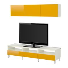 basement rec room?  IKEA - BESTÅ, TV storage combination, white/Tofta high-gloss/yellow,