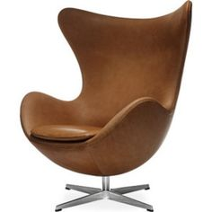 classic Egg chair Design inspired by Arne Jacobsen.Made in Denmark by Fritz Hansen. In 1958, Arne Jacobsen designed the Egg for the lobby and reception areas of the Royal Hotel in Copenhagen. This organically shaped chair has since become synonymous with Danish furniture design throughout the world