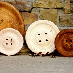 You could use wooden plates and drill holes, paint them to look like buttons for the sewing room wall decorations.