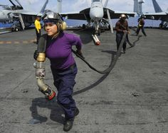 Aviation Boatswain's Mate Jessica Pena-Guerrero helps pull a fuel line across the flight deck of the aircraft carrier USS Ronald Reagan. #Navy #USNavy #AmericasNavy navy.com